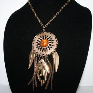 Long gold necklace with beautiful pendant